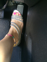 Addison driving in heels