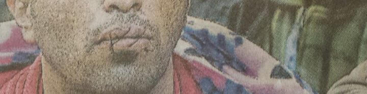 image d'un migrant qui a la bouche cousue