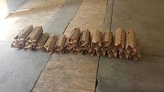 TROISIÈME AXE  papier cartonné (dossiers)  H 15 x L.15 x l.15 cm chacun  640 pliages réalisés par les élèves du Collège Jean Mermoz,Nozay, Loire Atlantique NULLE PART EST LE VIDE -20 05 2017 INSTALLATION IN SITU EN 3 AXES  Usine Atlas, Issé, Loire Atlantique