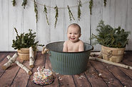 Baby in a green basket