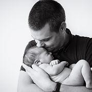 Father kissing his newborn child