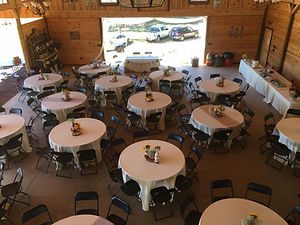 An overhead view of the reception room with table set up for dinner