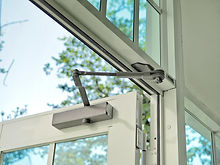 Door closer on modern glass door..jpg