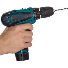 Hand of man holding small cordless elect