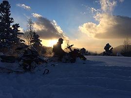 snowmobile sunset