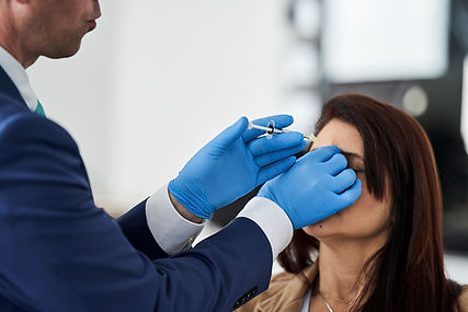 Dr. Wiser is injecting botox to a patient using a syringe