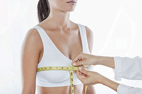 A woman's breast perimeter is being measured
