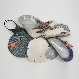 collection, shells, starfish, skate egg case, sand dollar, scallop, ocean, shore, sculpture, wall art, seashore, new england, marine sculpture, large sculpture, betsey rice, quonochontaug, rhode island artists, Glazed Stoneware