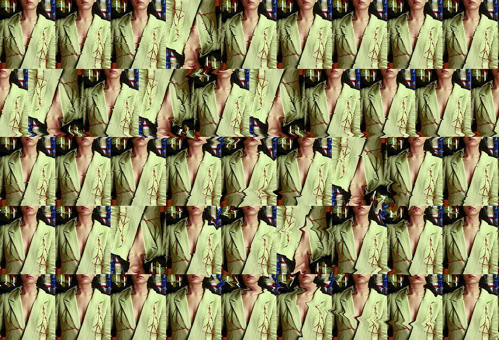 lior schwartzman green suit.png