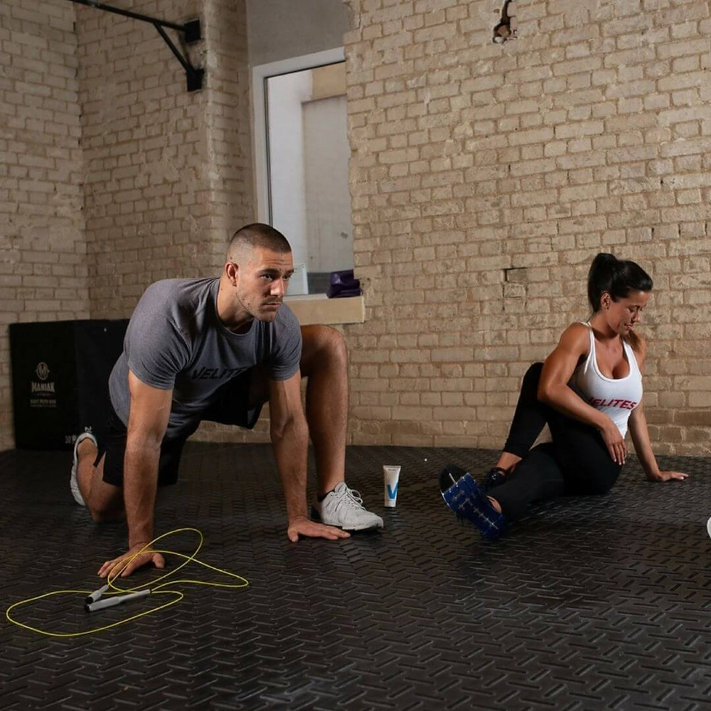 Strength & Conditioning Coaches Recommend You Do These 5 Things To Help Stay Committed To Your Fitness Goals During Lockdown