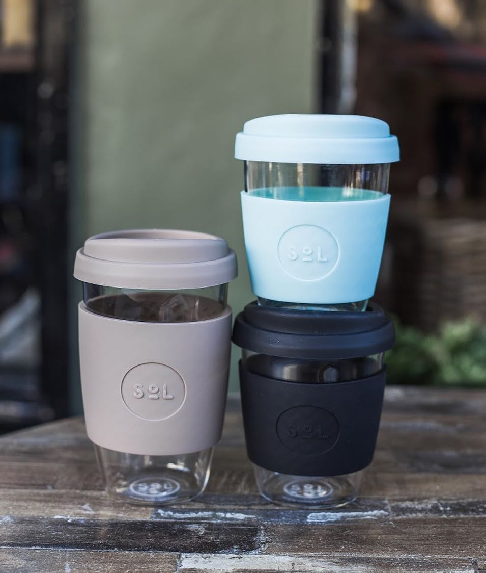 Plastic-free, gift-boxed, entirely reusable, hand blown glass travel cups & bottles by SoL Cups