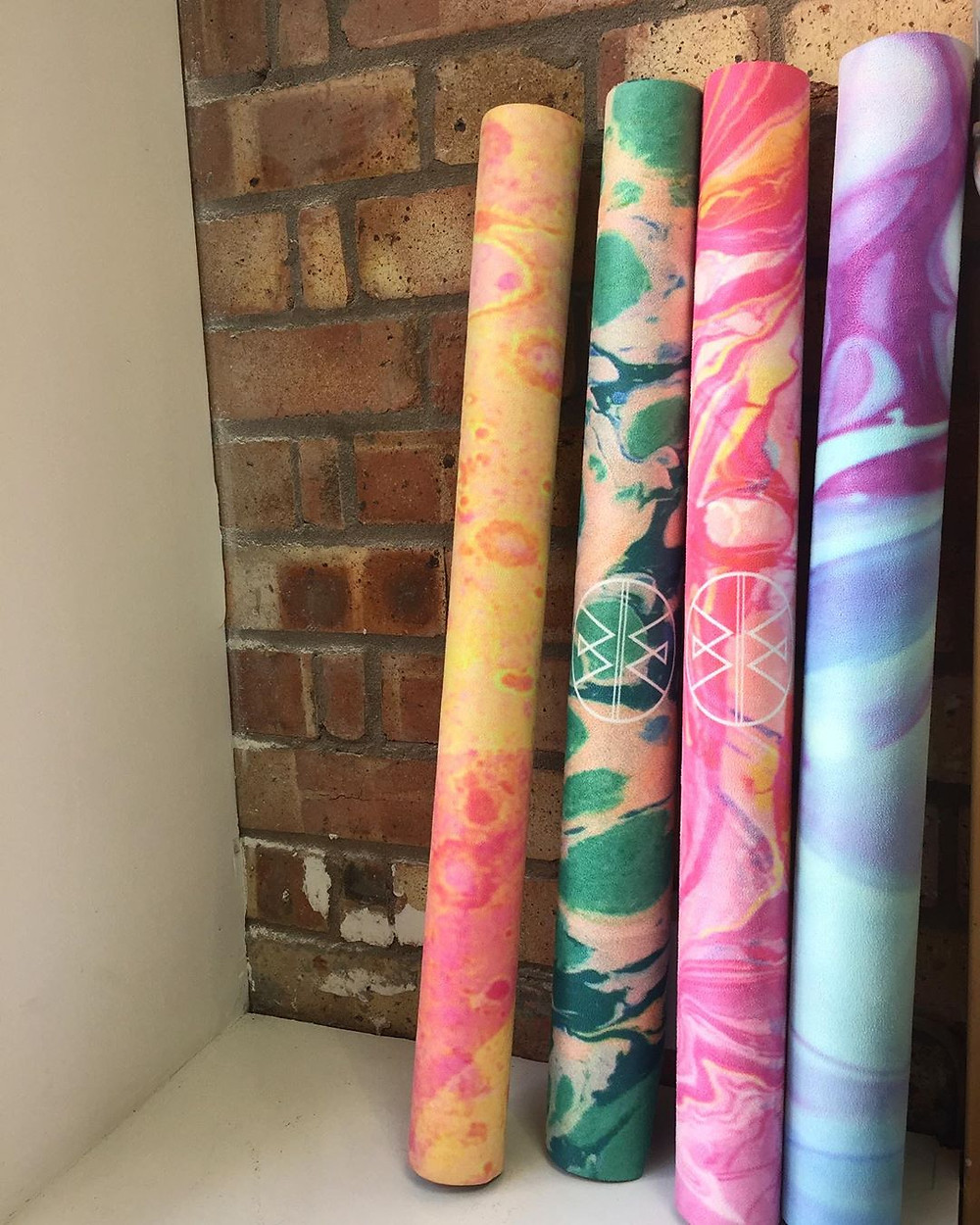 Wolf & Mermaid Eco-friendly and wonderfully unique Yoga & Meditation Mats, Bolsters, Cushions & Eye Pillows, drenched in abstract art designs and colours for conscious beings and wild souls.  All products are eco-friendly made with non toxic dyes and 100% organic filling.
