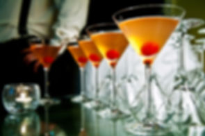 row of martinis in martini glasses