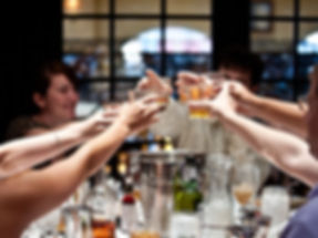people raising glasses in a toast