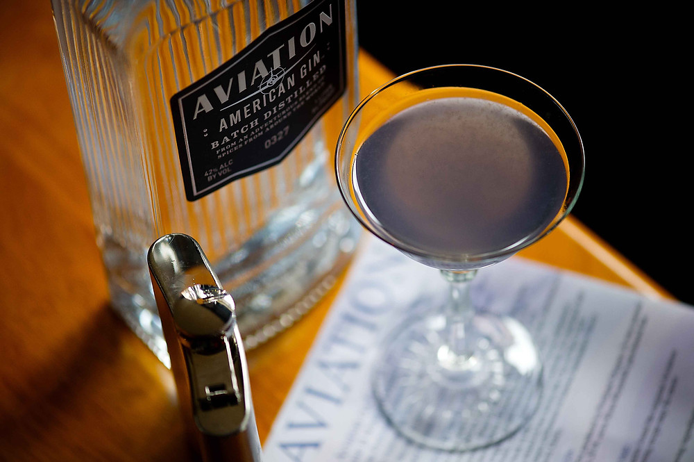 An Aviation cocktail with a bottle of Aviation gin, New Orleans, LA