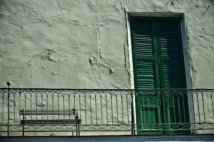 Empty bench and shutter door, French Quarter balcony, New Orleans, LA
