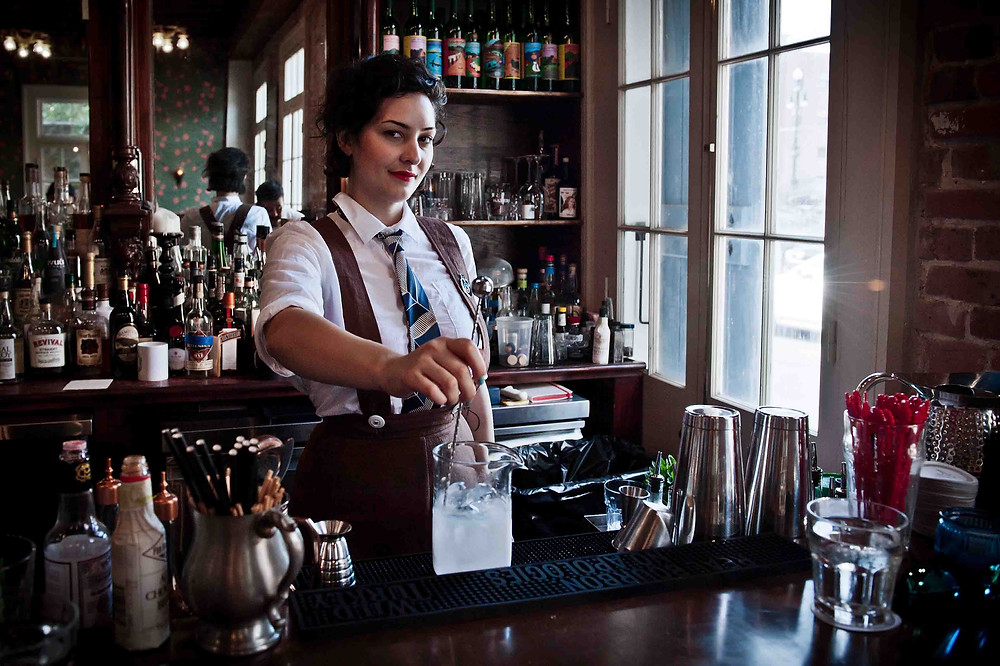 A female bartender stirs a cocktail, New Orleans, LA