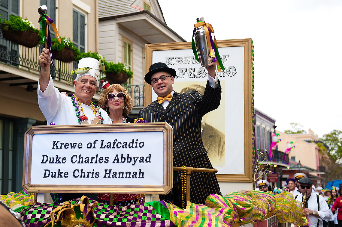 Three revelers riding a Mardi Gras float, New Orleans, LA