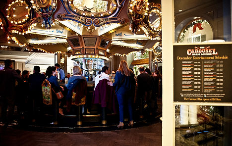 Patrons sit around the Carousel Bar, Hotel Monteleone, New Orleans, LA
