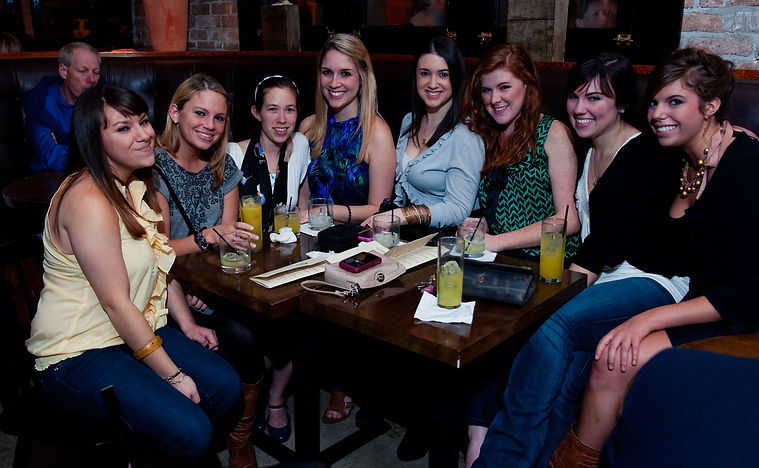 Eight bachelorettes enjoying cocktails, New Orleans, LA