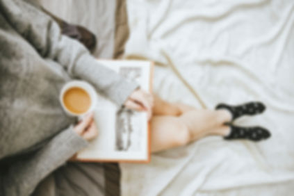Girl reading a book wth coffee