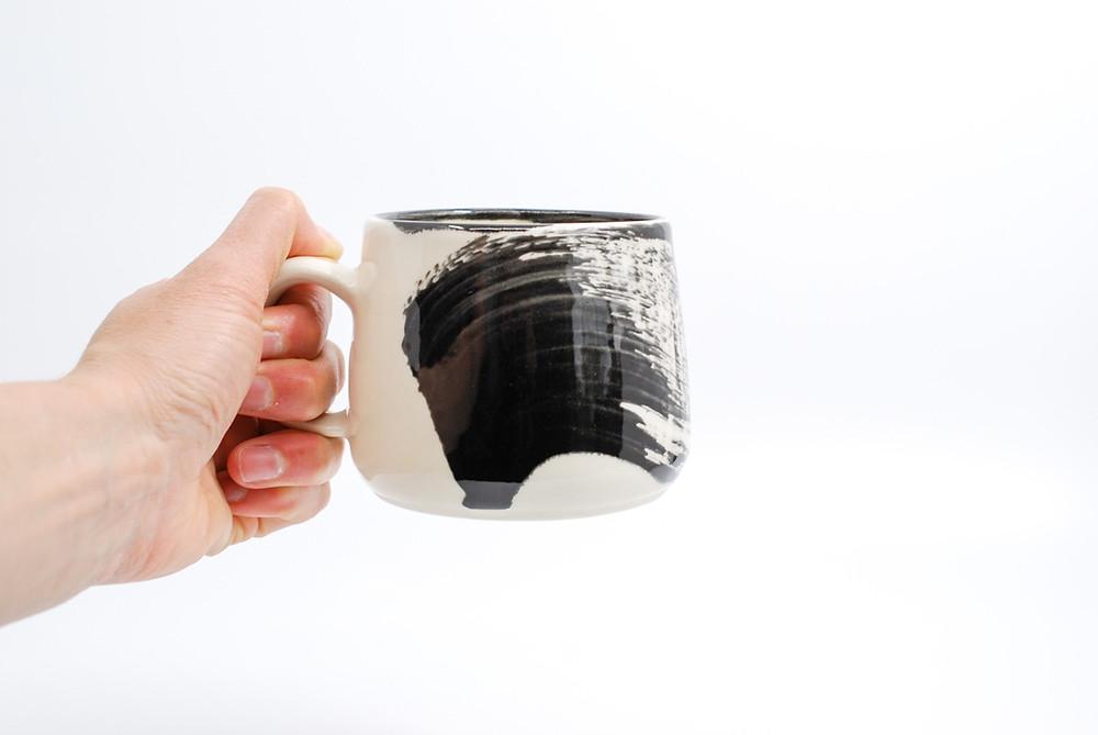 ceramic mug painted being held, Jenna Archer Ceramics, Calgary, Canada