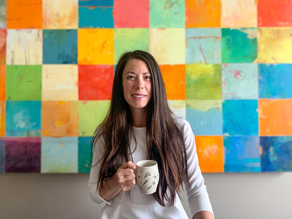 Jenna Archer // female ceramic artist // holding ceramic mug