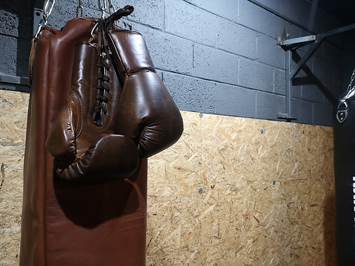 Brown Leather Punch Bag in Redwood