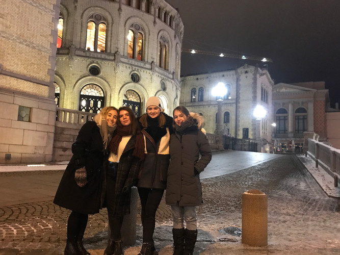 Sasha (far right) and her Co-Producer Sara (second from left) in front of the Norwegian Parliament with friends, Dec 2017