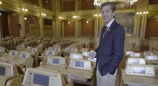MP Kristoffer Robin Haug in the main chamber of the Norwegian Parliament House