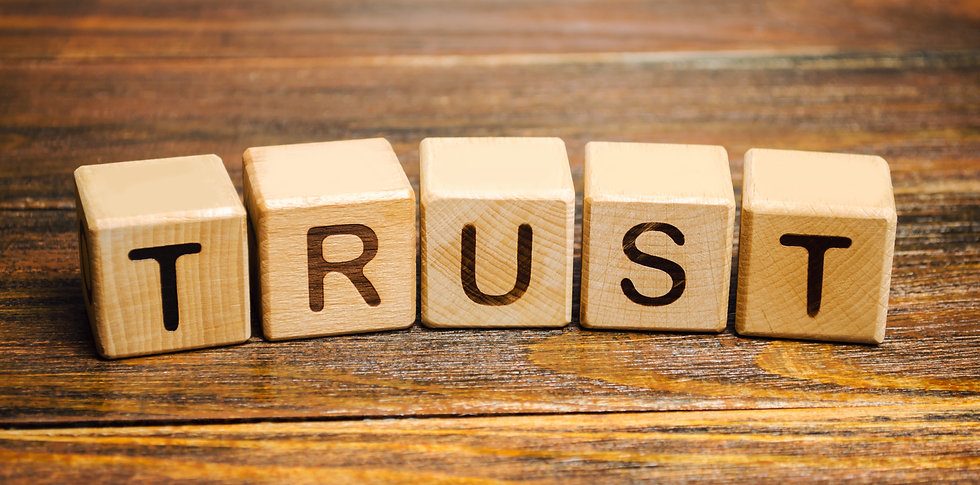 Wooden blocks with the word Trust. Trust