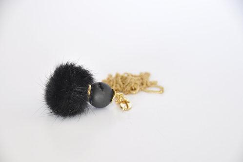Kettenanhänger aus schwarzem Fuchspelz & Geodenachat