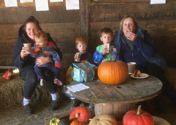 A Family Enjoying Cake and Coffee Refreshemnts From The Cafe