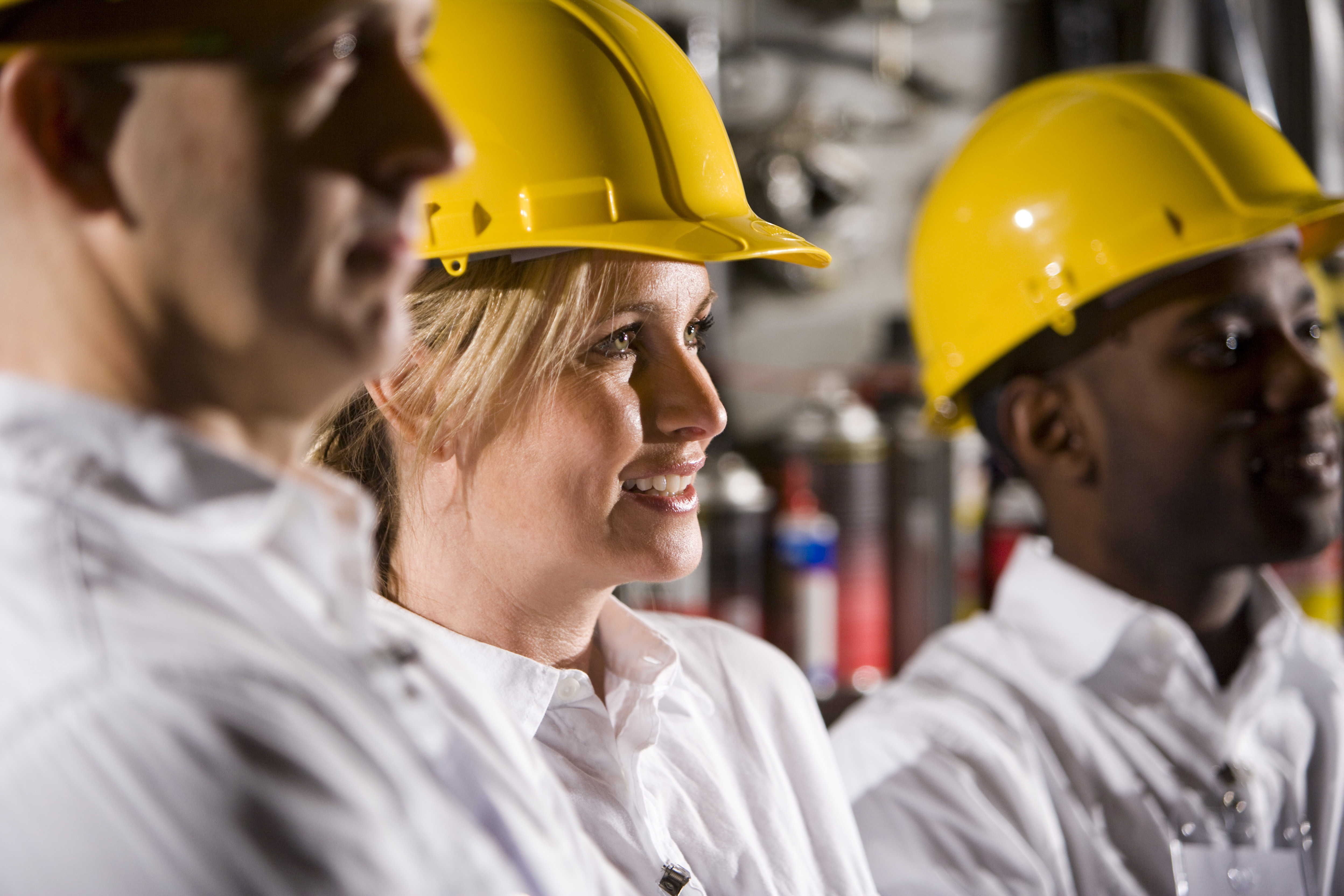Close up of coworkers wearing hard hats