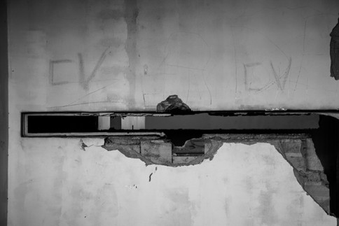 """A wall of a prision is marked by the letters """"CV"""", which stand for Comando Vermelho (rod command), one of the most important gangs in Brazil. Rio de Janeiro, 08/11/2016"""