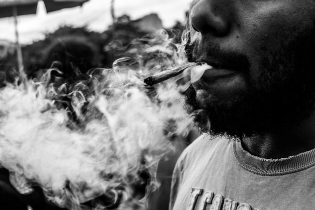A man smokes weed during a march for Marijuana's legalization in Rio. Rio de Janeiro, Brazil, 05/20/2017