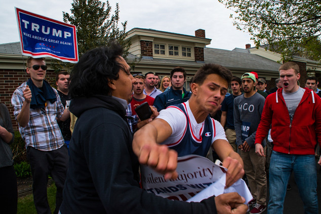 A Trump supporter tries to punch a latino protester during a rally in Warwick, Rhode Island. 05/11/2016