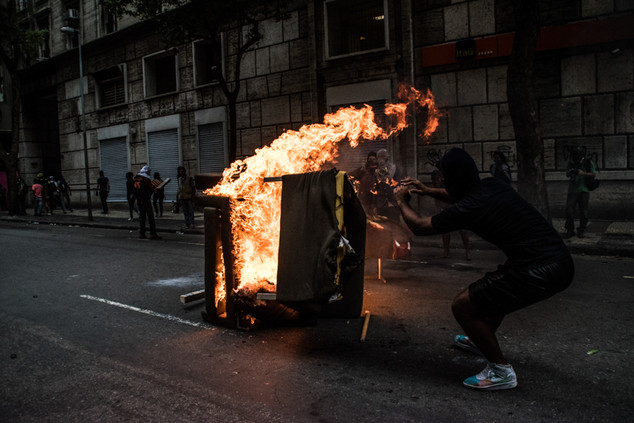 A protester throws a furniture in a barricade during a protest again privatization of Rio's water company. Rio de Janeiro,  02/09/2017