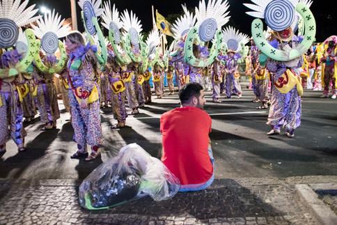 A man sits during a concentration of a samba school's parade during Rio's carnival. Rio de Janeiro, 02/11/2017