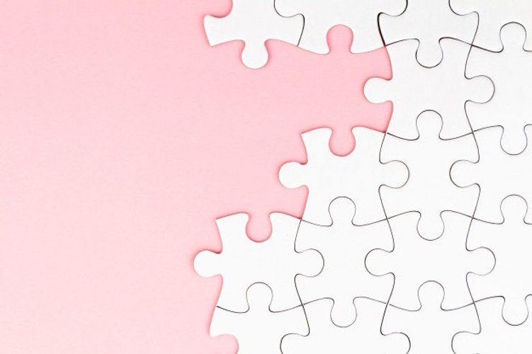 white-puzzle-pink-background-with-missing-pieces_72402-2548_edited.jpg