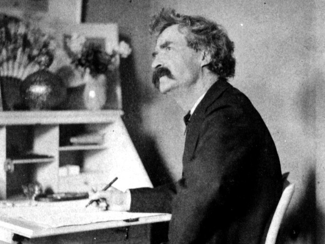 Mark_Twain_pondering_at_desk2.jpg