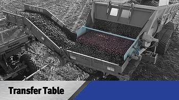 Transfer table crop shuttle seed loader.