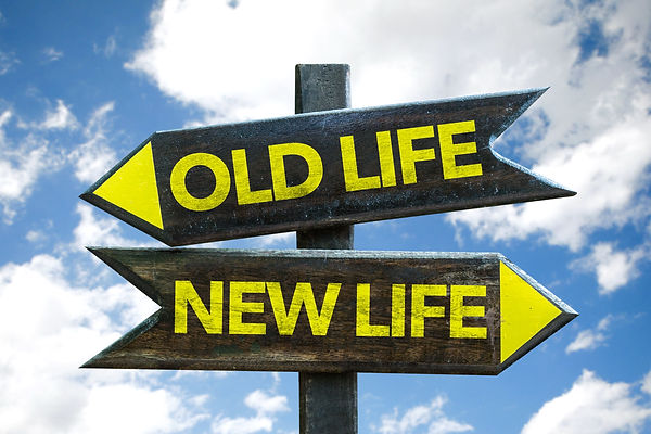 Old Life - New Life signpost with sky ba