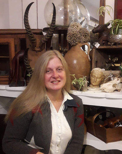 Sarah sat in front of some of the eclectic vintage items she finds.