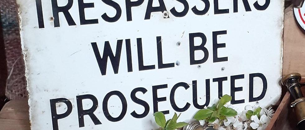 Enamel Trespassers sign