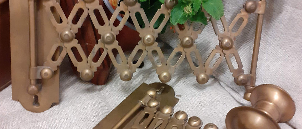 Pair extending brass candle holders