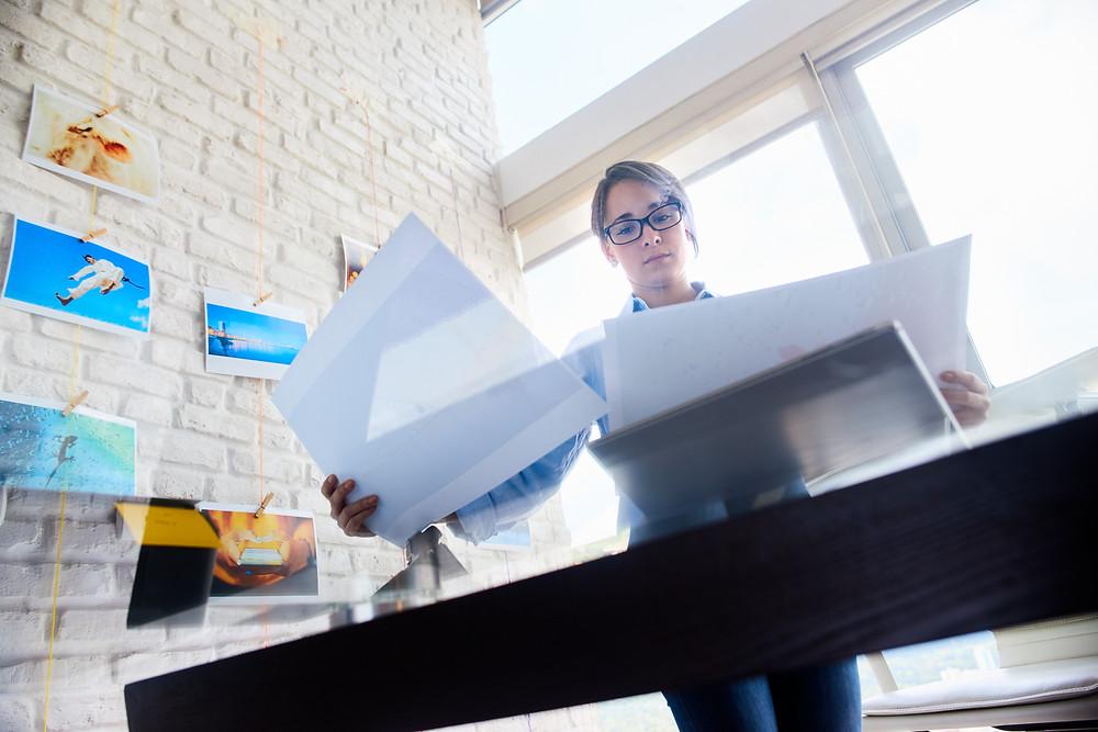 A brand designer checking prints for errors