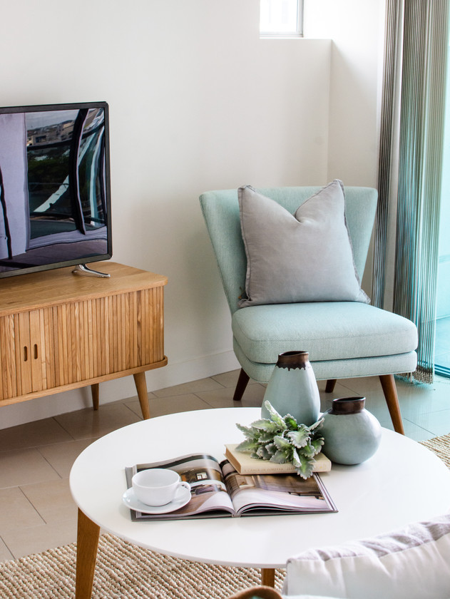 Pops of colour through furniture and accessoires stand out in realestate agent photographs.