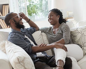 black-couple-talking-on-sofa-royalty-fre