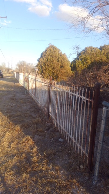 Perimeter fence before exterior painting by Quality Control Painting
